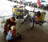 A Danish father teaches his son to strap down their touring bicycles on a ferry in Chile, in South America.