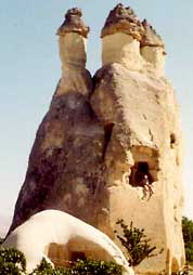 Here I am dangling out a Fairy Chimney built into a house in Cappadocia, Turkey.