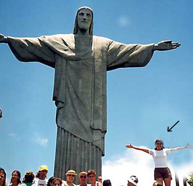 The famous statue Christ the Redeemer or Cristo Redentor in Rio de Janeiro. Note the imposter (arrow.)