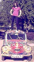 My friend Rose standing on her psychedelic car in 1971.