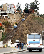 Here is a great place to get lost on a bus in Valparaiso, Chili.  Note the homemade funicular trams crawling up the hillside.
